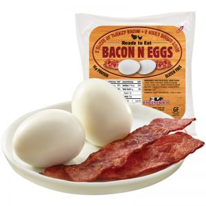 Cheesewich Bacon N Egg Package with glamour image of 2 hard boiled eggs and 2 slices of terkey bacon.