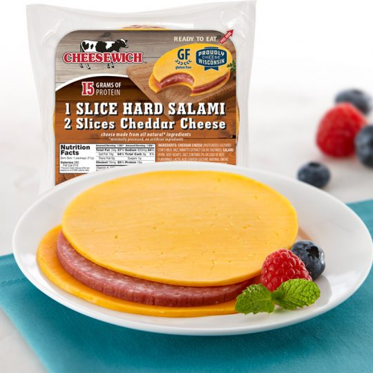Appetizing picture of Cheddar Cheesewich™ on plate and image of packaged product in background.