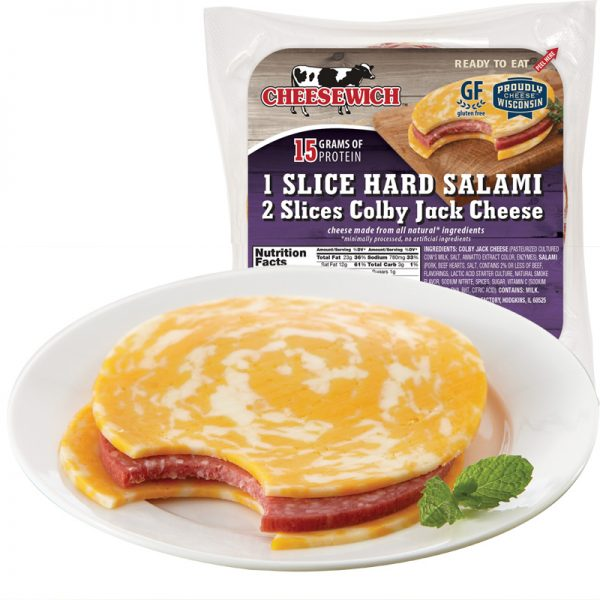 Cloby Jack Cheesewich on plate with bite out of it and a packaged purple flavor color in background