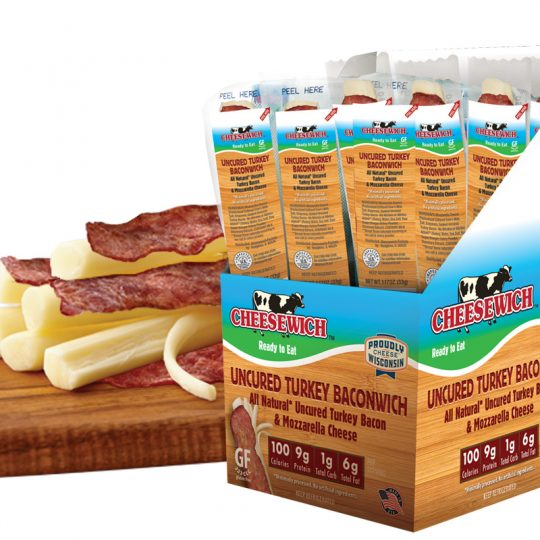 Mozzarella string cheese and All Natural Uncured Turkey Bacon in vacuum packed packaging with label. Product open and on cutting board.